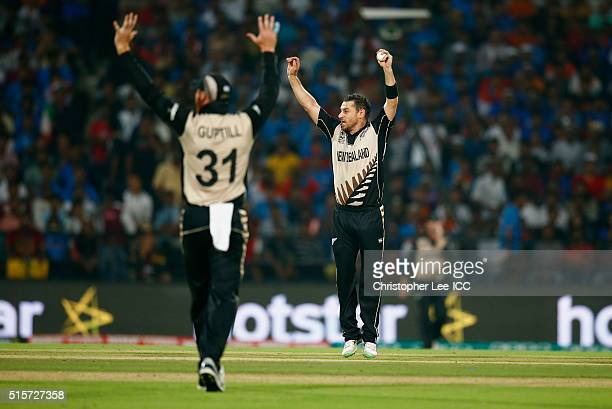 Nathan McCullum of New Zealand appeals and gets the the wicket of Yuvraj Singh of India after catching him out from his own bowling during the ICC...