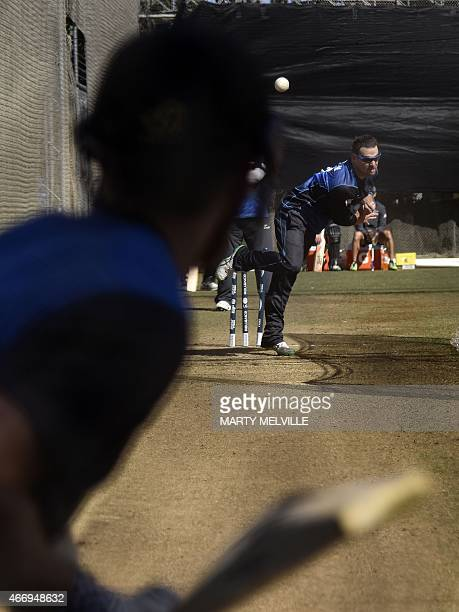 Nathan McCullum of New Zealand bowls during a training session ahead of their 2015 Cricket World Cup quarterfinal match against the West Indies at...