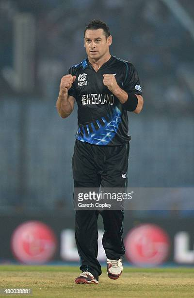 Nathan McCullum of New Zealand celebrates dismissing Chris Jordan of England during the ICC World Twenty20 Bangladesh 2014 group 1 match between...