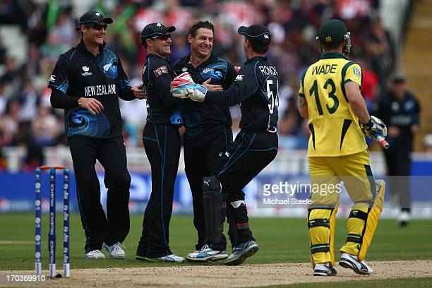 Nathan McCullum of New Zealand celebrates with Martin Guptill Brendon McCullum and Luke Ronchi after trapping Matthew Wade of Australia during the...