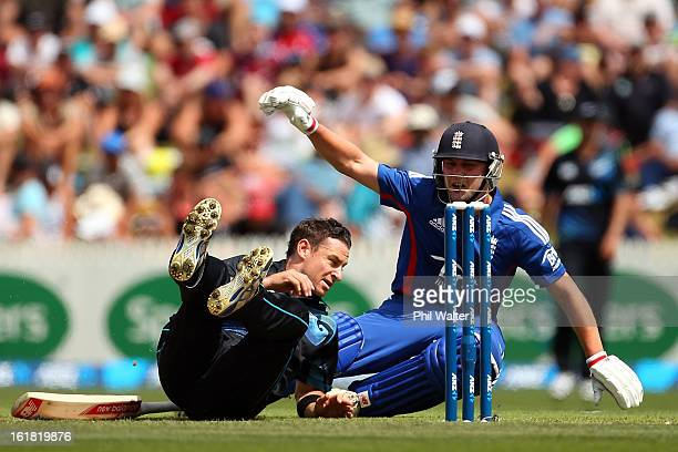 Nathan McCullum of New Zealand collides with Jonathan Trott of England during the first match of the one day international series between New Zealand...