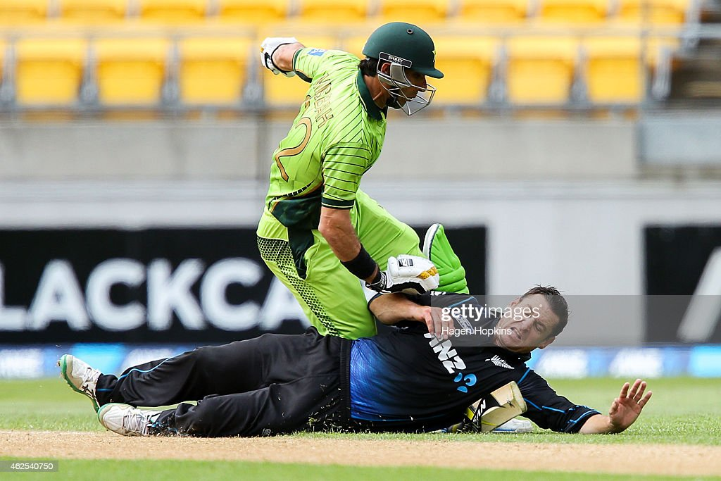 <a gi-track='captionPersonalityLinkClicked' href=/galleries/search?phrase=Nathan+McCullum&family=editorial&specificpeople=884481 ng-click='$event.stopPropagation()'>Nathan McCullum</a> of New Zealand collides with <a gi-track='captionPersonalityLinkClicked' href=/galleries/search?phrase=Misbah-ul-Haq&family=editorial&specificpeople=2180557 ng-click='$event.stopPropagation()'>Misbah-ul-Haq</a> of Pakistan while attempting to field off his own bowling during the One Day International match between New Zealand and Pakistan at Westpac Stadium on January 31, 2015 in Wellington, New Zealand.