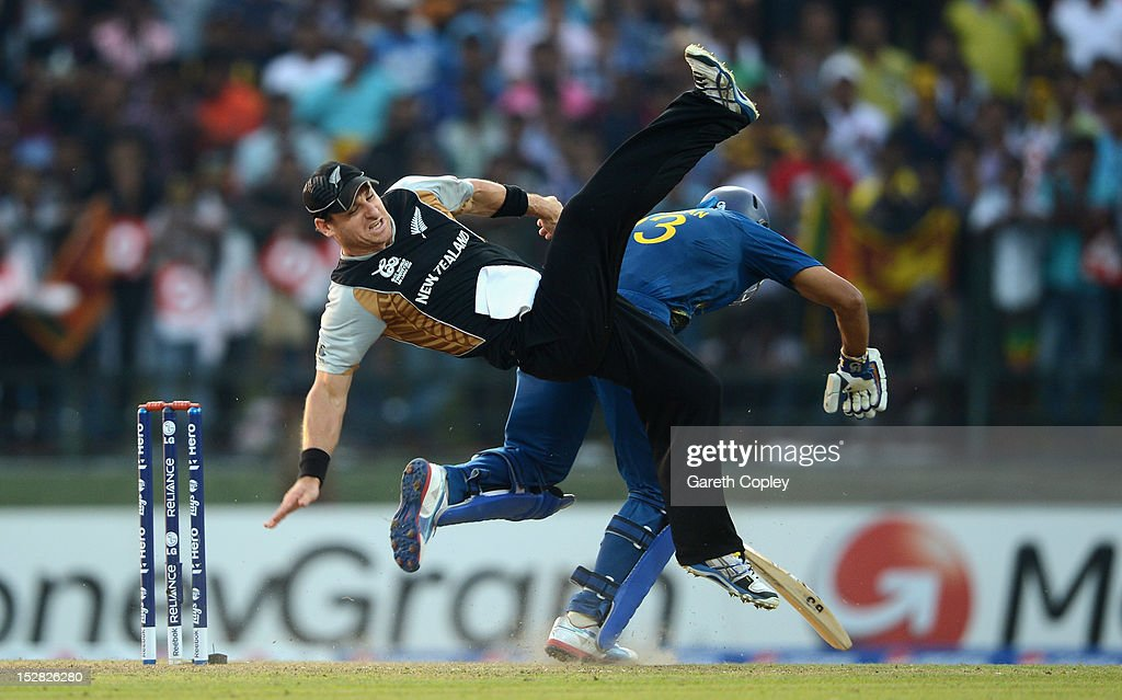<a gi-track='captionPersonalityLinkClicked' href=/galleries/search?phrase=Nathan+McCullum&family=editorial&specificpeople=884481 ng-click='$event.stopPropagation()'>Nathan McCullum</a> of New Zealand collides with <a gi-track='captionPersonalityLinkClicked' href=/galleries/search?phrase=Tillakaratne+Dilshan&family=editorial&specificpeople=239186 ng-click='$event.stopPropagation()'>Tillakaratne Dilshan</a> of Sri Lanka during the ICC World Twenty20 2012 Super Eights Group 1 match between Sri Lanka and New Zealand at Pallekele Cricket Stadium on September 27, 2012 in Kandy, Sri Lanka.