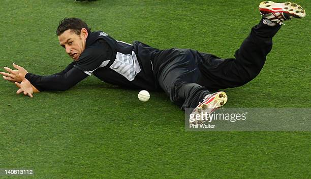 Nathan McCullum of New Zealand fumbles a catch during the One Day International match between New Zealand and South Africa at Eden Park on March 3...