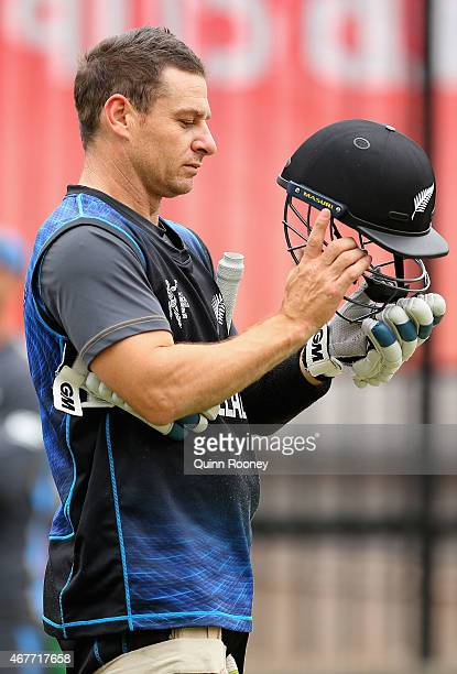 Nathan McCullum of New Zealand puts on his helmet during a New Zealand nets session at Melbourne Cricket Ground on March 27 2015 in Melbourne...
