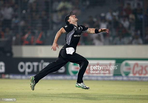 Nathan McCullum of New Zealand runs for an attempted catch during 2011 ICC World Cup QuarterFinal match between New Zealand and South Africa at...
