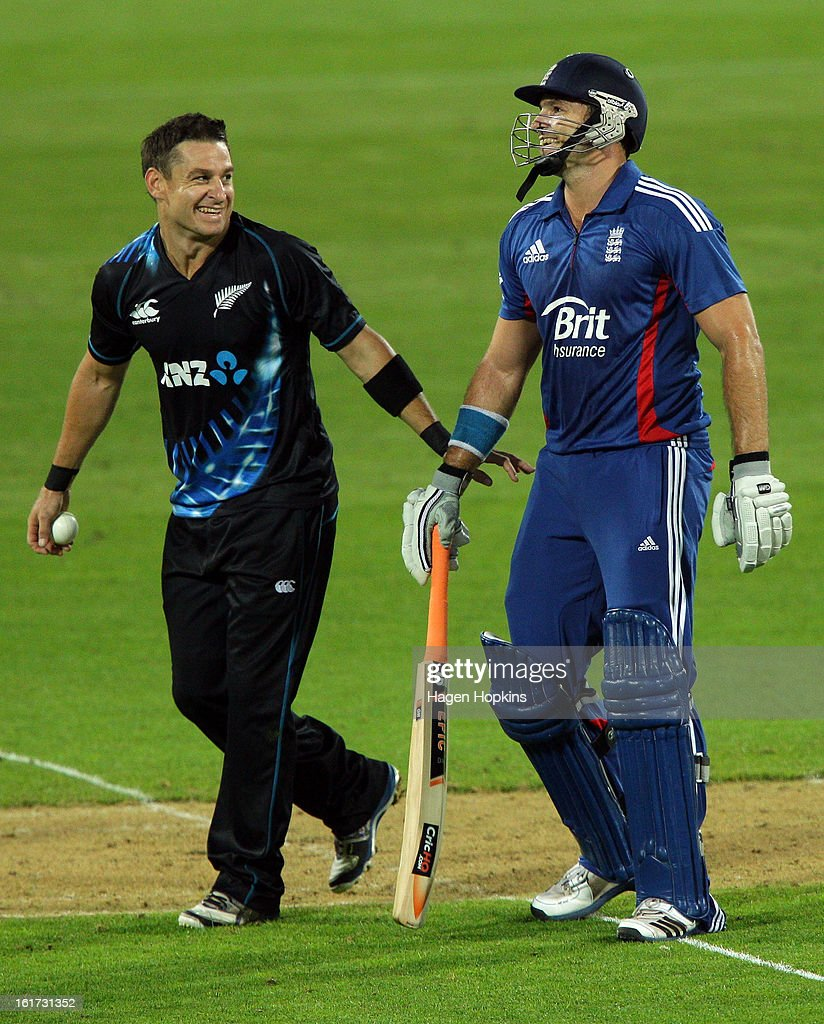 <a gi-track='captionPersonalityLinkClicked' href=/galleries/search?phrase=Nathan+McCullum&family=editorial&specificpeople=884481 ng-click='$event.stopPropagation()'>Nathan McCullum</a> of New Zealand shares a laugh with Michael Lumb of England during the third Twenty20 International match between New Zealand and England at Westpac Stadium on February 15, 2013 in Wellington, New Zealand.