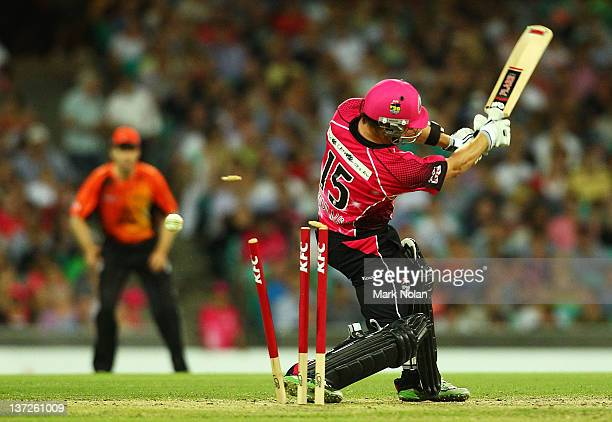 Nathan McCullum of the Sixers is bowled by Ben Edmondson of the Scorchers during the T20 Big Bash League match between the Sydney Sixers and the...