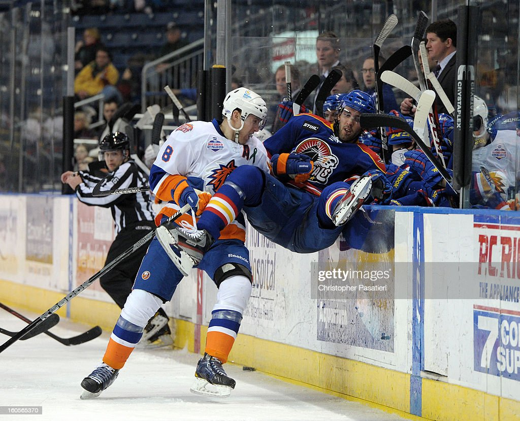 Nathan McIver #8 of the Bridgeport Sound Tigers checks Josh Brittain #13 of the Norfolk Admirals into the bench during an American Hockey League game on February 2, 2013 at the Webster Bank Arena at Harbor Yard in Bridgeport, Connecticut.