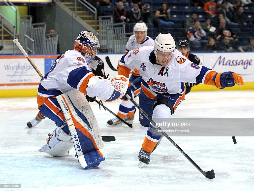 Nathan McIver #8 of the Bridgeport Sound Tigers clears the puck from in front of <a gi-track='captionPersonalityLinkClicked' href=/galleries/search?phrase=Rick+DiPietro&family=editorial&specificpeople=201931 ng-click='$event.stopPropagation()'>Rick DiPietro</a> #39 during an American Hockey League game against the Adirondack Phantoms on March 2, 2013 at the Webster Bank Arena at Harbor Yard in Bridgeport, Connecticut.
