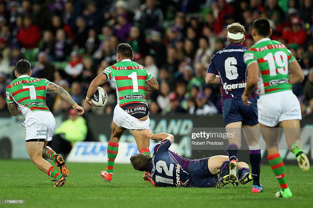 Nathan Merritt of the Rabbitohs breaks a tackle applied by Ryan Hoffman of the Storm during the round 22 NRL match between the Melbourne Storm and the South Sydney Rabbitohs at AAMI Park on August 9, 2013 in Melbourne, Australia.
