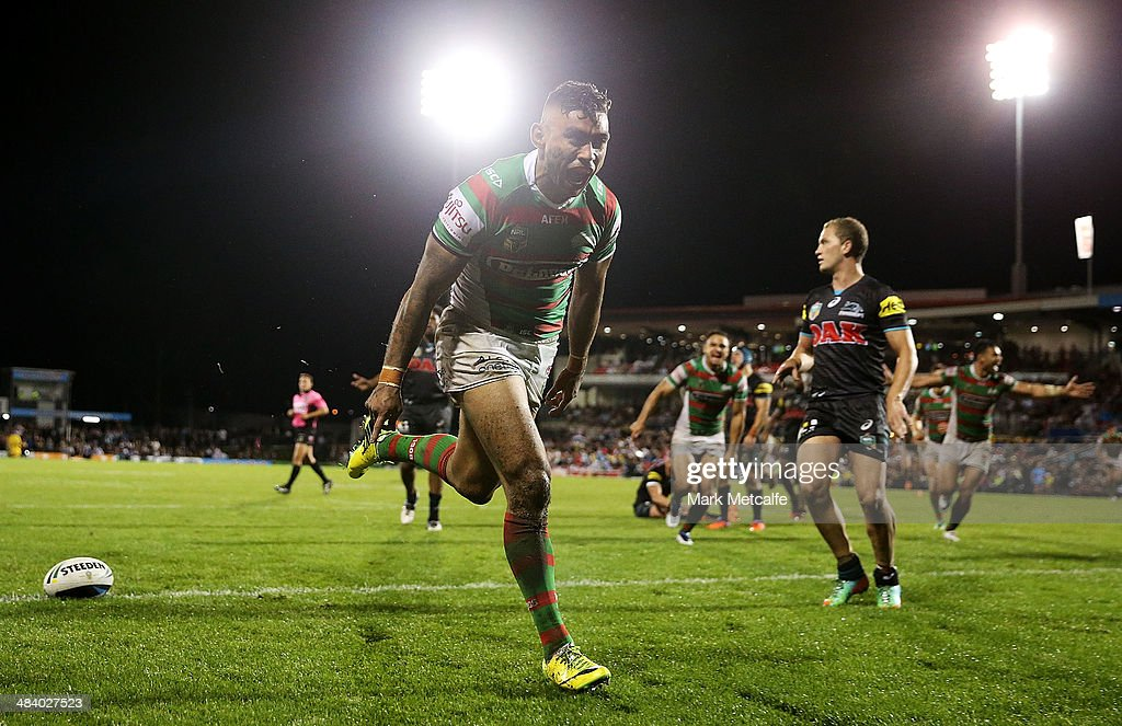<a gi-track='captionPersonalityLinkClicked' href=/galleries/search?phrase=Nathan+Merritt&family=editorial&specificpeople=563463 ng-click='$event.stopPropagation()'>Nathan Merritt</a> of the Rabbitohs celebrates scoring a try during the round 6 NRL match between the Penrith Panthers and the South Sydney Rabbitohs at Sportingbet Stadium on April 11, 2014 in Sydney, Australia.
