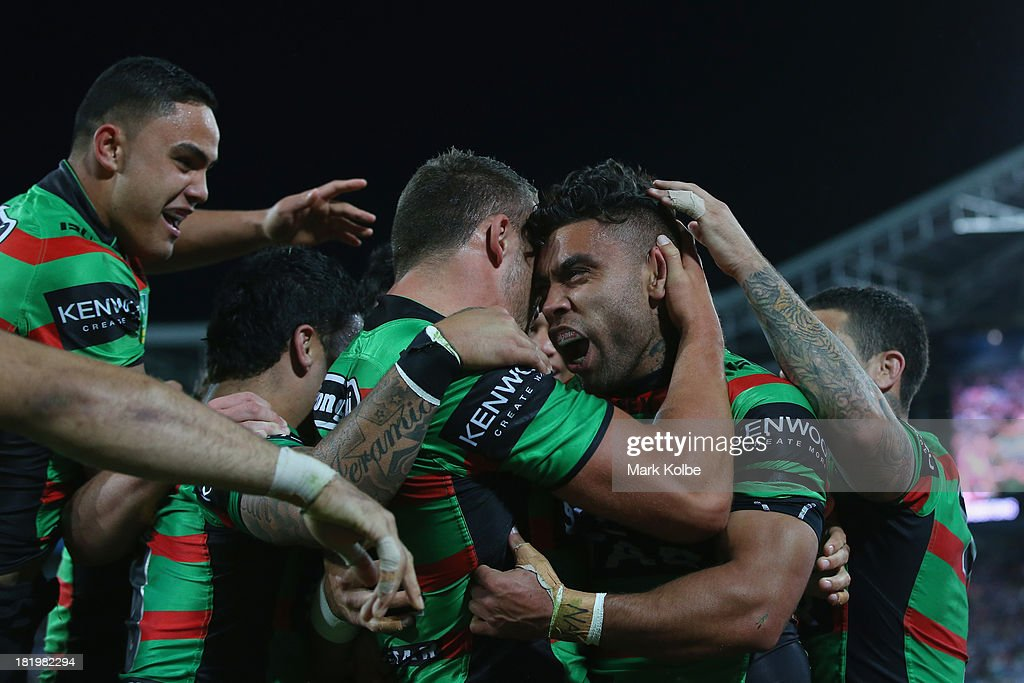 <a gi-track='captionPersonalityLinkClicked' href=/galleries/search?phrase=Nathan+Merritt&family=editorial&specificpeople=563463 ng-click='$event.stopPropagation()'>Nathan Merritt</a> of the Rabbitohs celebrates with his team after scoring a try during the NRL Preliminary Final match between the South Sydney Rabbitohs and the Manly Warringah Sea Eagles at ANZ Stadium on September 27, 2013 in Sydney, Australia.