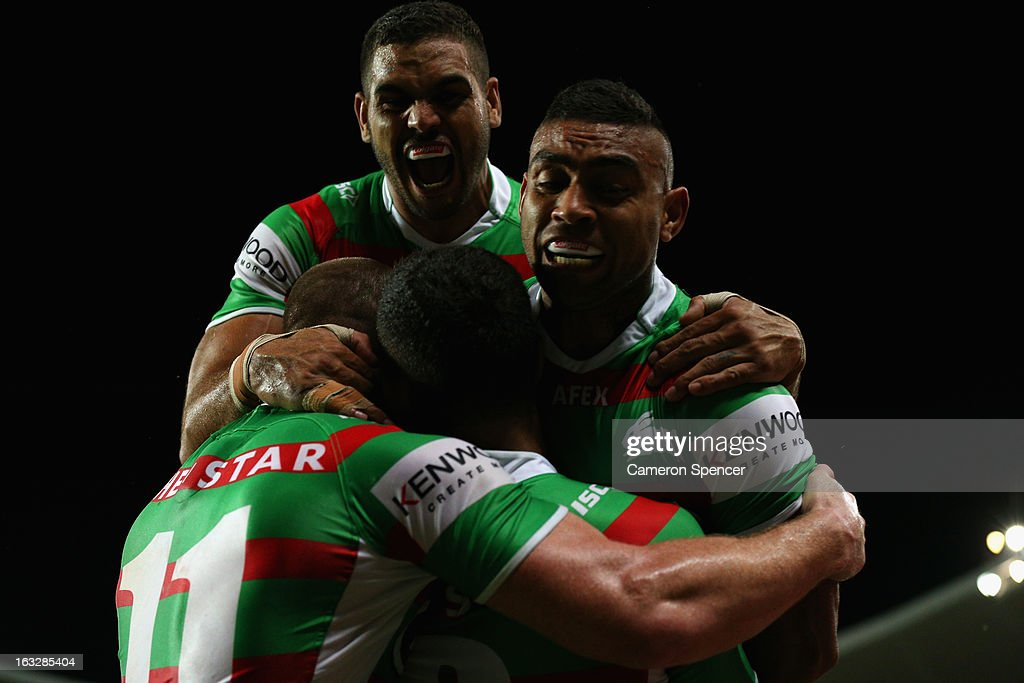 Nathan Merritt of the Rabbitohs celebrates with team mates after scoring a try during the round one NRL match between the Sydney Roosters and the South Sydney Rabbitohs at Allianz Stadium on March 7, 2013 in Sydney, Australia.
