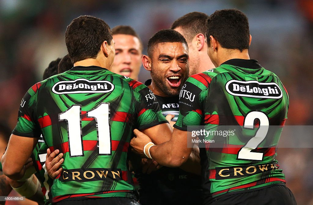 <a gi-track='captionPersonalityLinkClicked' href=/galleries/search?phrase=Nathan+Merritt&family=editorial&specificpeople=563463 ng-click='$event.stopPropagation()'>Nathan Merritt</a> of the Rabbitohs celebrates with team mates after scoring during the round 14 NRL match between the South Sydney Rabbitohs and the Wests Tigers at ANZ Stadium on June 13, 2014 in Sydney, Australia.