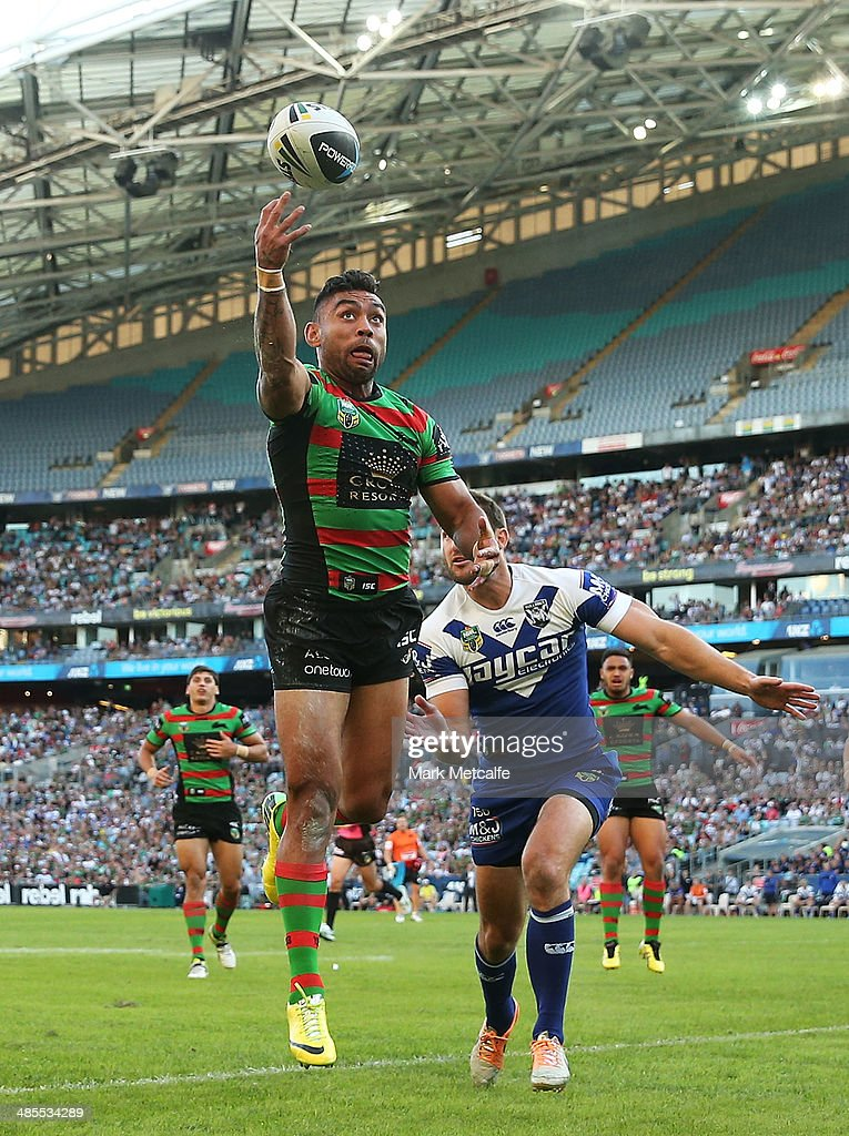 Nathan Merritt of the Rabbitohs fails to gather the ball over the try line as he is tackled by Mitch Brown of the Bulldogs during the round seven NRL match between the South Sydney Rabbitohs and the Canterbury-Bankstown Bulldogs at ANZ Stadium on April 18, 2014 in Sydney, Australia.