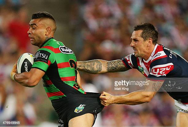 Nathan Merritt of the Rabbitohs is tackled by Mitchell Pearce of the Roosters during the round one NRL match between the South Sydney Rabbitohs and...