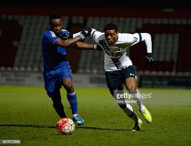 Nathan Oduwa of Tottenham Hotspur is tackled by Fankaty Dabo of Chelsea during the Barclays U21 Premier League International Cup match between...
