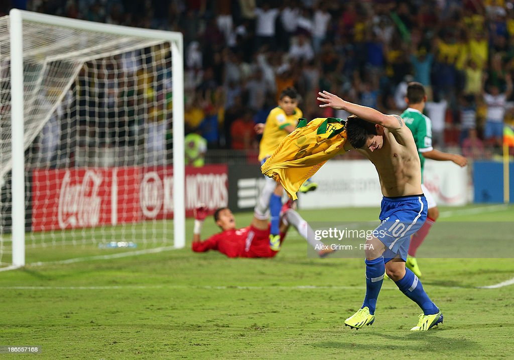 <a gi-track='captionPersonalityLinkClicked' href=/galleries/search?phrase=Nathan+-+Brazilian+Soccer+Player&family=editorial&specificpeople=11628591 ng-click='$event.stopPropagation()'>Nathan</a> of Brazil celebrates his team's first goal during the FIFA U-17 World Cup UAE 2013 Quarter Final match between Brazil and Mexico at Al Rashid Stadium on November 1, 2013 in Dubai, United Arab Emirates.