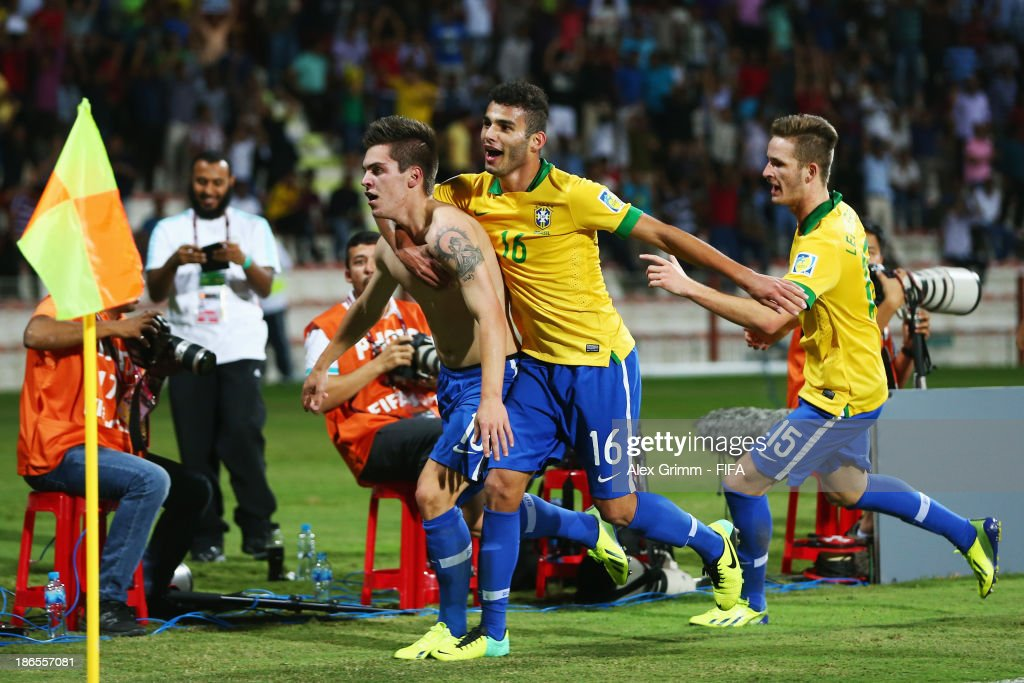 <a gi-track='captionPersonalityLinkClicked' href=/galleries/search?phrase=Nathan+-+Brazilian+Soccer+Player&family=editorial&specificpeople=11628591 ng-click='$event.stopPropagation()'>Nathan</a> of Brazil celebrates his team's first goal with team mates Thiago Maia and Leo Pereira (L-R) during the FIFA U-17 World Cup UAE 2013 Quarter Final match between Brazil and Mexico at Al Rashid Stadium on November 1, 2013 in Dubai, United Arab Emirates.