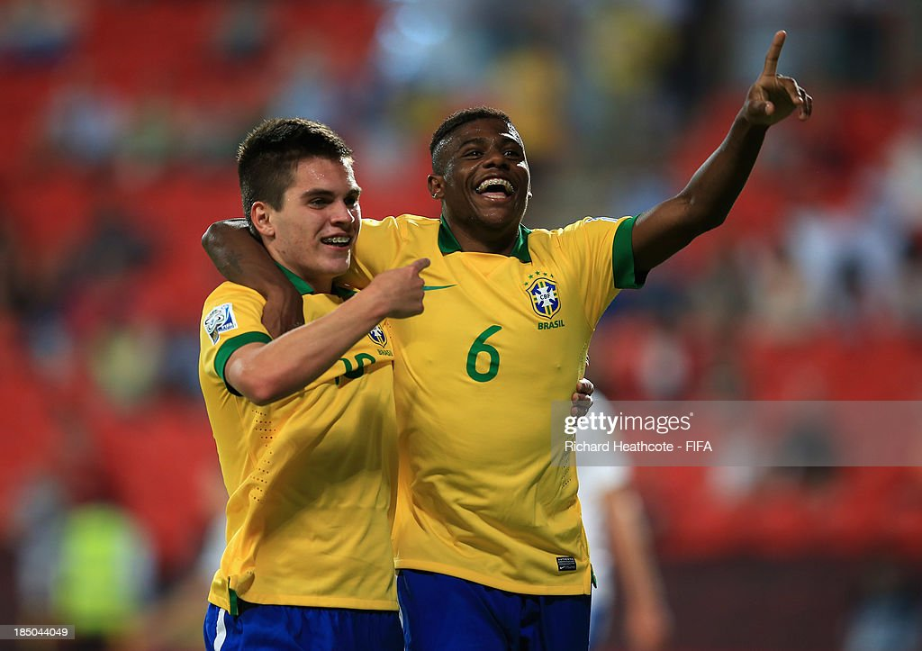 <a gi-track='captionPersonalityLinkClicked' href=/galleries/search?phrase=Nathan+-+Brazilian+Soccer+Player&family=editorial&specificpeople=11628591 ng-click='$event.stopPropagation()'>Nathan</a> of Brazil celebrates scoreing the fourth goal with Abner during the FIFA U-17 World Cup UAE 2013 group A match between Brazil and Slovakia at the Mohamed Bin Zayed Stadium on October 17, 2013 in Abu Dhabi, United Arab Emirates.