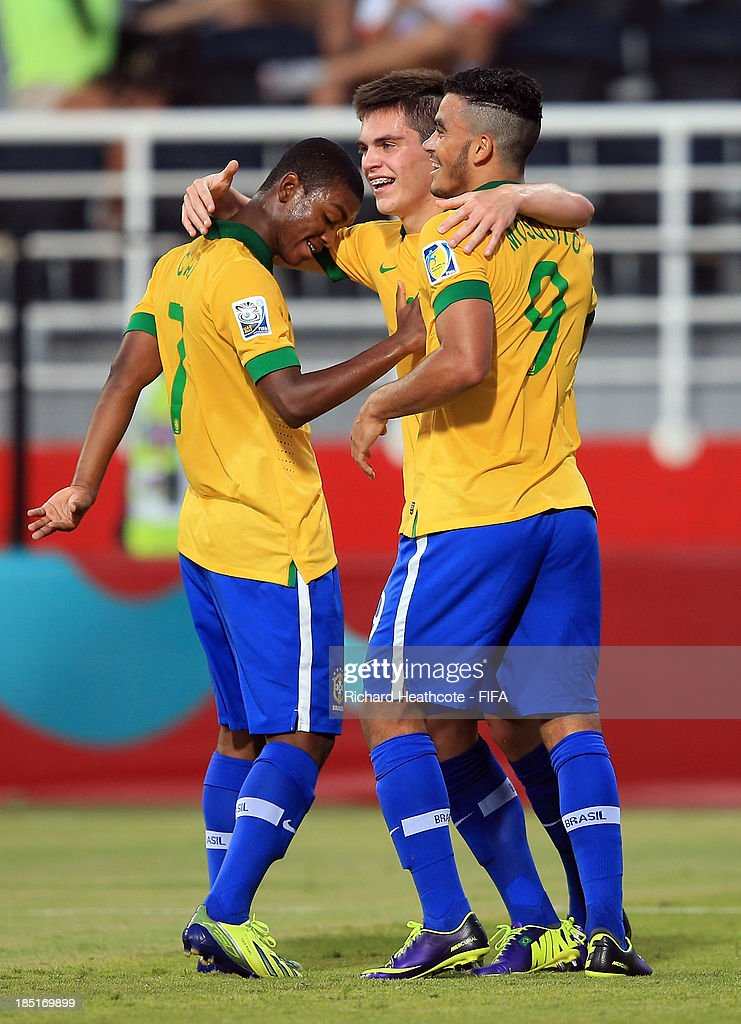 <a gi-track='captionPersonalityLinkClicked' href=/galleries/search?phrase=Nathan+-+Brazilian+Soccer+Player&family=editorial&specificpeople=11628591 ng-click='$event.stopPropagation()'>Nathan</a> of Brazil celebrates scoring his first goal with Caio and Mosquito during the FIFA U-17 World Cup UAE 2013 group A match between Brazil and Slovakia at the Mohamed Bin Zayed Stadium on October 17, 2013 in Abu Dhabi, United Arab Emirates.
