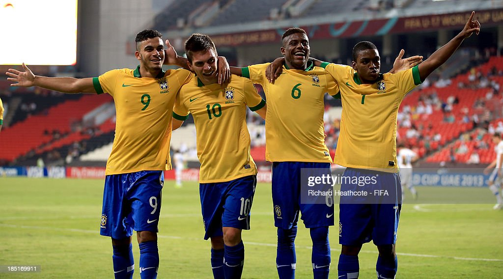 <a gi-track='captionPersonalityLinkClicked' href=/galleries/search?phrase=Nathan+-+Brazilian+Soccer+Player&family=editorial&specificpeople=11628591 ng-click='$event.stopPropagation()'>Nathan</a> of Brazil #10 celebrates scoring his second goal with Mosquito #9, Abner #6 and Caio #7 during the FIFA U-17 World Cup UAE 2013 group A match between Brazil and Slovakia at the Mohamed Bin Zayed Stadium on October 17, 2013 in Abu Dhabi, United Arab Emirates.