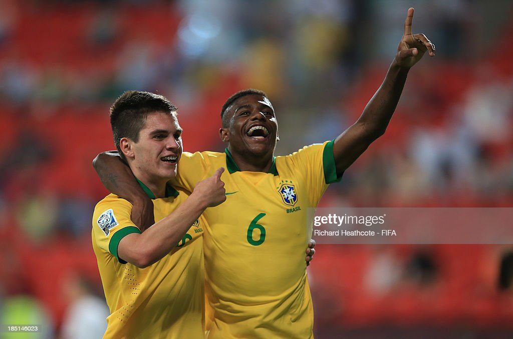 <a gi-track='captionPersonalityLinkClicked' href=/galleries/search?phrase=Nathan+-+Brazilian+Soccer+Player&family=editorial&specificpeople=11628591 ng-click='$event.stopPropagation()'>Nathan</a> of Brazil celebrates scoring the fourth goal with Abner during the FIFA U-17 World Cup UAE 2013 group A match between Brazil and Slovakia at the Mohamed Bin Zayed Stadium on October 17, 2013 in Abu Dhabi, United Arab Emirates.