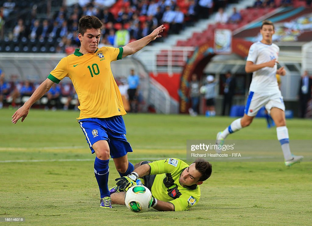<a gi-track='captionPersonalityLinkClicked' href=/galleries/search?phrase=Nathan+-+Brazilian+Soccer+Player&family=editorial&specificpeople=11628591 ng-click='$event.stopPropagation()'>Nathan</a> of Brazil is brought down by Martin Junas of Slovakia to win a penalty during the FIFA U-17 World Cup UAE 2013 group A match between Brazil and Slovakia at the Mohamed Bin Zayed Stadium on October 17, 2013 in Abu Dhabi, United Arab Emirates.
