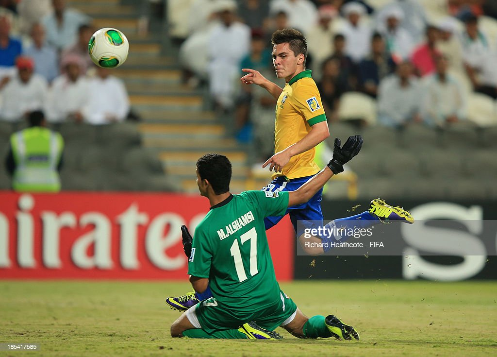 <a gi-track='captionPersonalityLinkClicked' href=/galleries/search?phrase=Nathan+-+Brazilian+Soccer+Player&family=editorial&specificpeople=11628591 ng-click='$event.stopPropagation()'>Nathan</a> of Brazil scores the fourth goal during the FIFA U-17 World Cup UAE 2013 Group A match between United Arab Emirates and Brazil at the Mohamed Bin Zayed Stadium on October 20, 2013 in Abu Dhabi, United Arab Emirates.