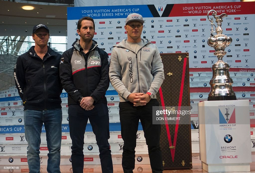 Nathan Outteridge (L), of Artemis Racing, Ben Ainsle (C), of Land Rover BAR, Jimmy Spithill, of Oracle Team USA, pose for photos at the Skippers news conference for the Louis Vuitton America's Cup World Series New York May 5, 2016 in New York. / AFP / DON