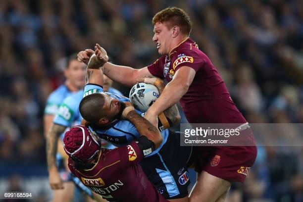 Nathan Peats of the Blues is tackled during game two of the State Of Origin series between the New South Wales Blues and the Queensland Maroons at...