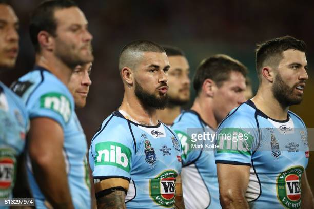 Nathan Peats of the Blues looks on during game three of the State Of Origin series between the Queensland Maroons and the New South Wales Blues at...