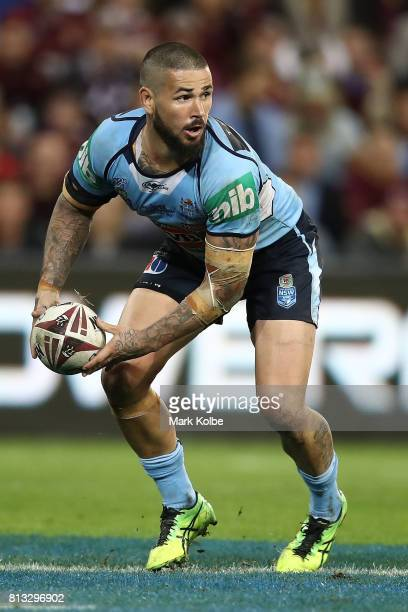 Nathan Peats of the Blues offloads the ball during game three of the State Of Origin series between the Queensland Maroons and the New South Wales...