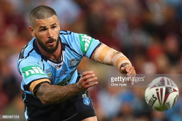 Nathan Peats of the Blues passes during game one of the State Of Origin series between the Queensland Maroons and the New South Wales Blues at...
