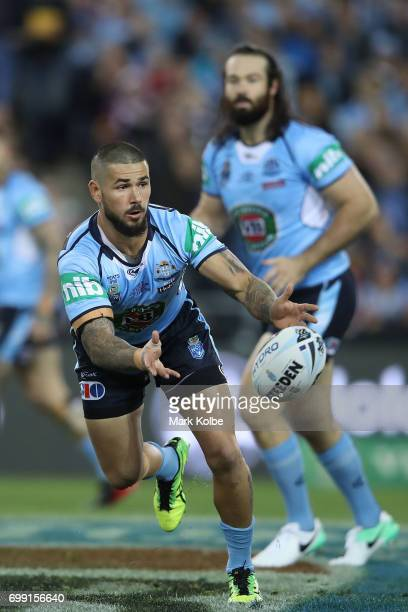 Nathan Peats of the Blues passes the ball during game two of the State Of Origin series between the New South Wales Blues and the Queensland Maroons...