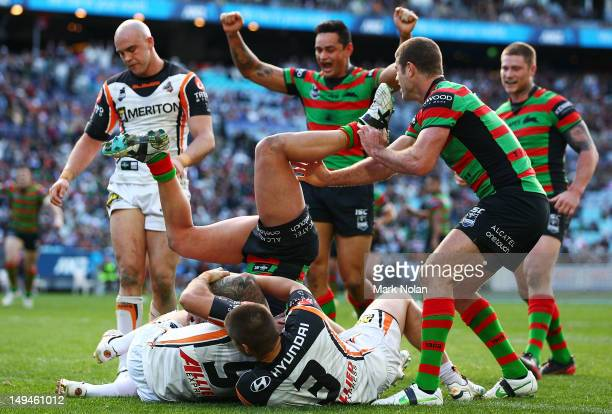 Nathan Peats of the Rabbitohs scores during the round 21 NRL match between the South Sydney Rabbitohs and the Wests Tigers at ANZ Stadium on July 29...