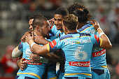 Nathan Peats of the Titans celebrates with his team mates after scoring a try during the round 19 NRL match between the St George Illawarra Dragons...