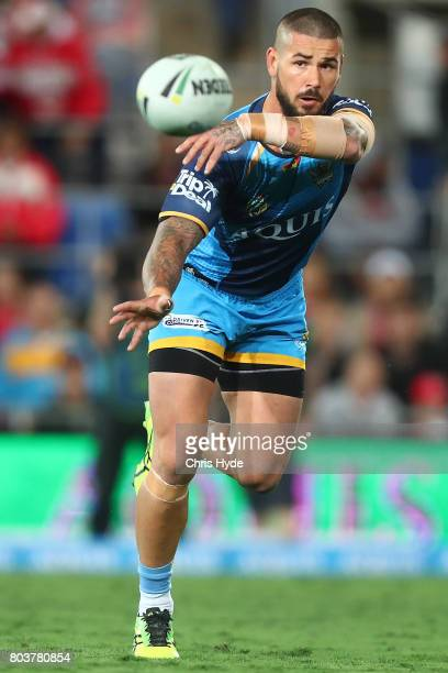 Nathan Peats of the Titans passes during the round 17 NRL match between the Gold Coast Titans and the St George Illawarra Dragons at Cbus Super...