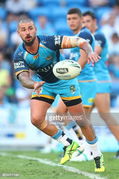 Nathan Peats of the Titans passes during the round 21 NRL match between the Gold Coast Titans and the Wests Tigers at Cbus Super Stadium on July 30...