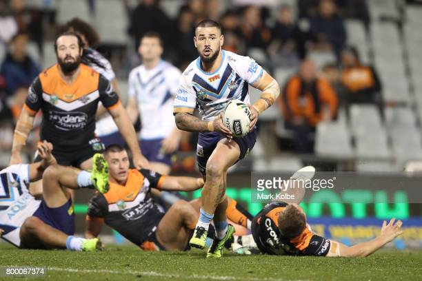 Nathan Peats of the Titans runs the ball during the round 16 NRL match between the Wests Tigers and the Gold Coast Titans at Campbelltown Sports...