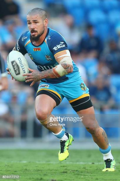 Nathan Peats of the Titans runs the ball during the round 21 NRL match between the Gold Coast Titans and the Wests Tigers at Cbus Super Stadium on...