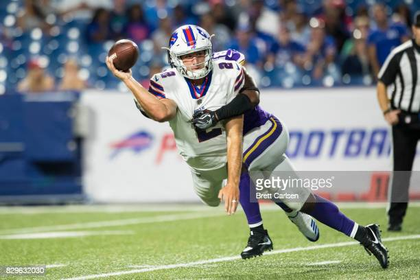 Nathan Peterman of the Buffalo Bills gets off a incomplete pass to avoid a sack by Horace Richardson of the Minnesota Vikings during the fourth...