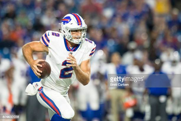 Nathan Peterman of the Buffalo Bills scrambles with the ball during the second half of a preseason gameof a preseason gameagainst the Minnesota...