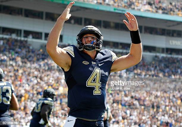 Nathan Peterman of the Pittsburgh Panthers celebrates after a 1 yard touchdown in the first half during the game against the Penn State Nittany Lions...