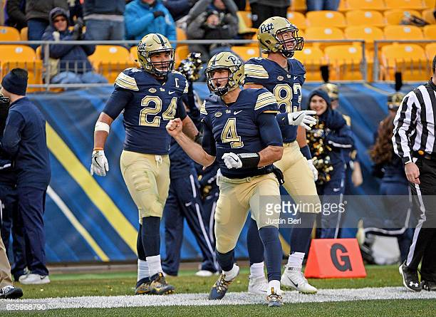 Nathan Peterman of the Pittsburgh Panthers reacts after rushing for a 13 yard touchdown in the second quarter during the game against the Syracuse...