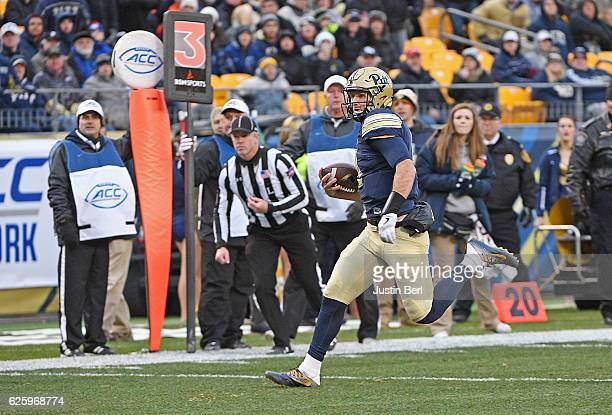 Nathan Peterman of the Pittsburgh Panthers rushes for a 13 yard touchdown in the second quarter during the game against the Syracuse Orange at Heinz...