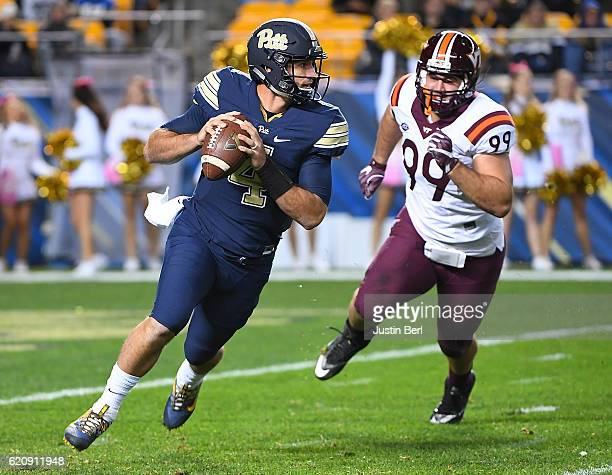 Nathan Peterman of the Pittsburgh Panthers scrambles to avoid the rush of Vinny Mihota of the Virginia Tech Hokies in the first half during the game...