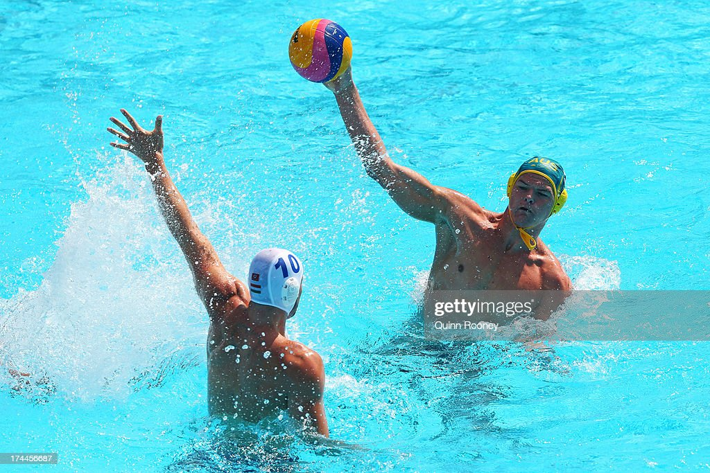 Nathan Power of Australia in action against Denes Varga of Hungary during the Men's Water Polo first preliminary round match between Hungary and...
