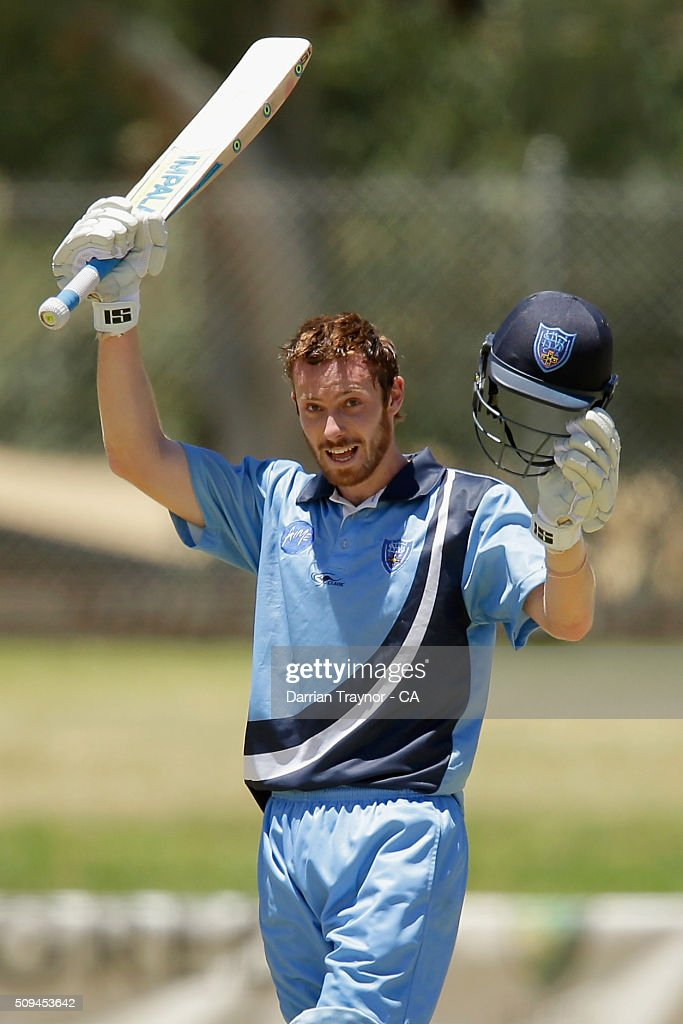 Nathan Price of New South Wales raises his bat after scoring 100 runs against Western Australia duringday 4 of the National Indigenous Cricket Championships on February 11, 2016 in Alice Springs, Australia.